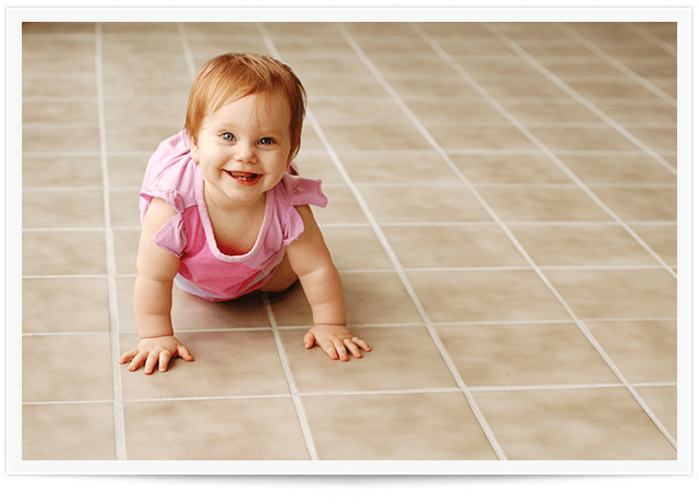 baby crawling on clean tile in fort smith home